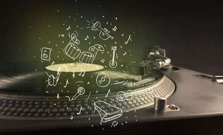 Turntable playing classical music with icon drawn instruments concept on background photo