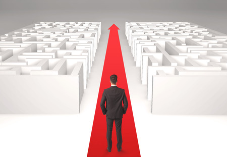 Successful businessman in front of a separated labyrinth, concept about simple solution photo