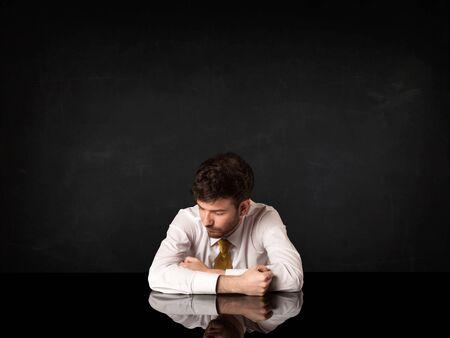 sad businessman: Depressed businessman sitting at a desk