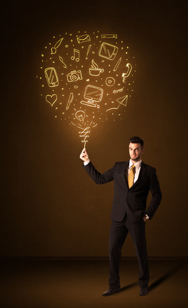Businessman holding a social media shining balloon on a brown background photo
