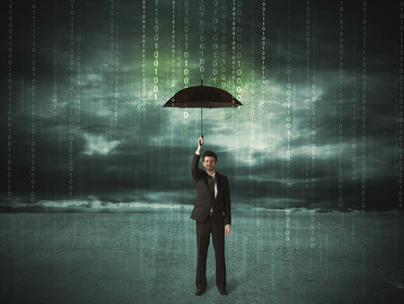 Business man standing with umbrella data protection concept on background photo
