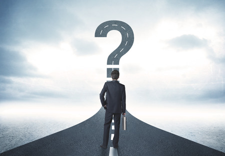 Business person lokking at road with question mark sign concept photo