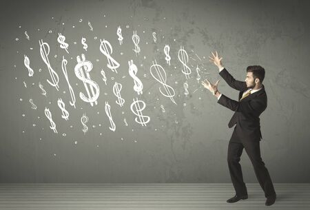 man holding sign: Young business people with hand drawn dollar signs concept Stock Photo