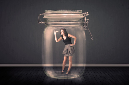 suffocating: Businesswoman trapped into a glass jar concept on background Stock Photo