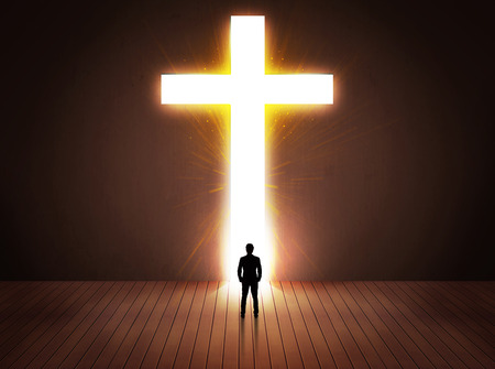jesus in heaven: Man looking at bright cross sign concept