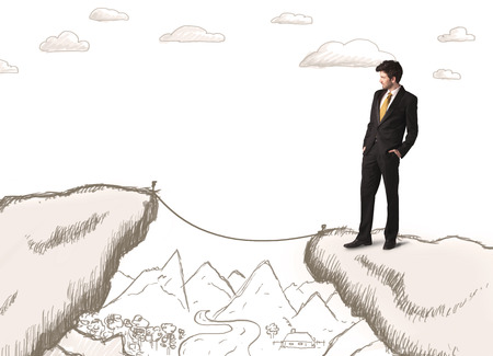bridging the gaps: Businessman standing on the hand drawn edge of mountain Stock Photo