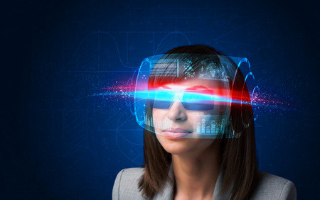 artificial light: Future woman with high tech smart glasses concept Stock Photo