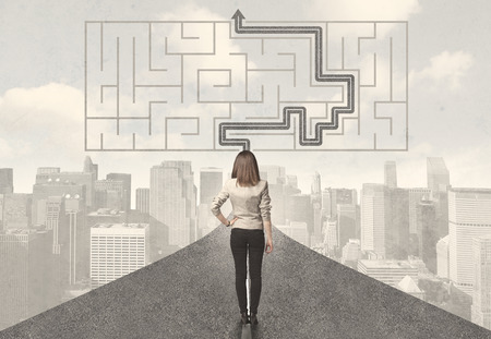 Business woman looking at road with maze and solution concept Stock Photo