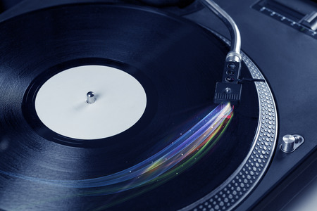 audiophile: Music player playing vinyl music with colourful abstract lines concept on background