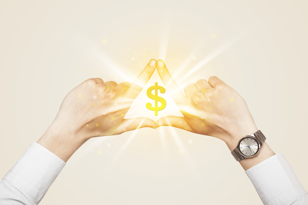 dollar sign: Hands creating a form with shining dollar sign in the center Stock Photo