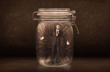 suffocating: Businessman inside a jar with powerful hand drawn lines concept on bakcground