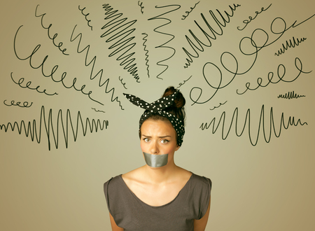 dismay: Young woman with taped mouth and curly lines around her head Stock Photo