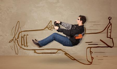 壁の概念に飛行機を描かれて面白いパイロット運転手 写真素材