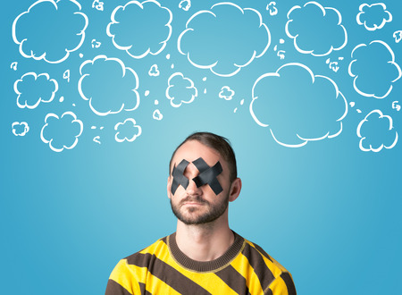 Funny person with taped mouth and hand drawn clouds around head Stock Photo