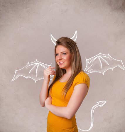 naughty girl: Young nasty girl with devil horns and wings drawing Stock Photo