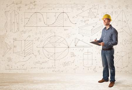 손으로 그린 배경 개념으로 계산하는 잘 생긴 엔지니어 스톡 콘텐츠