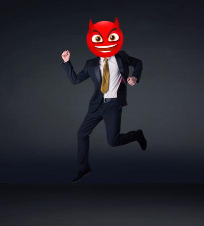 red devil: Funny businessman wears devil smiley face