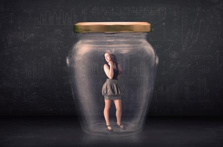 shut: Businesswoman shut inside a glass jar concept on background Stock Photo