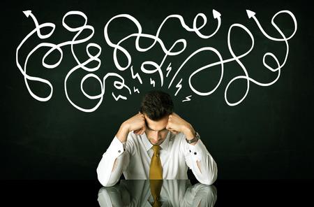 indecisive: Depressed businessman sitting under white drawn direction lines Stock Photo