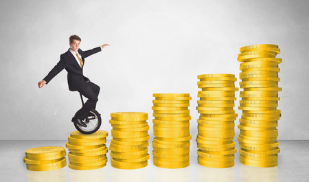 cash cycle: Business man riding monocycle up on coin graph concept on white background