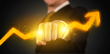 Business person holding a hot glowing upright arrow concept on background photo