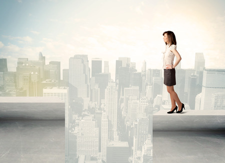 bridging: Businesswoman standing on the edge of rooftop with city background