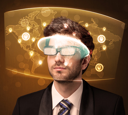 futuristic man: Young man looking at futuristic social network map concept Stock Photo