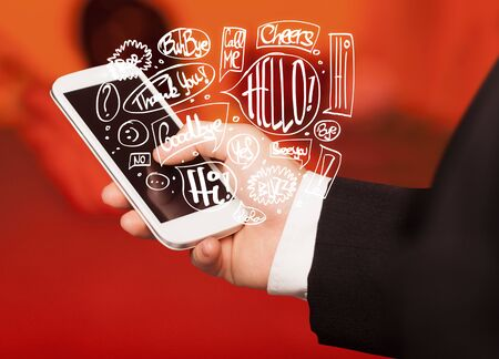 hand holding phone: Hand holding phone with hand drawn speech bubbles concept Stock Photo