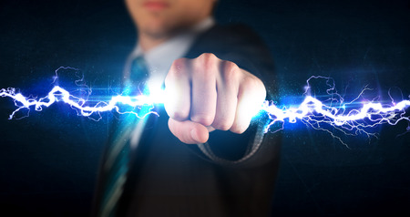 Business man holding electricity light bolt in his hands concept Stock Photo - 41459701