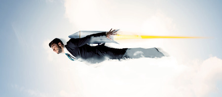 fun at work: Business man flying like a superhero in clouds on the sky concept Stock Photo