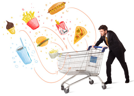 food  white: Businessman pushing a shopping cart and toxic junk food and cigarettes coming out of it