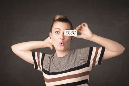 Funny woman looking with hand drawn paper eyes concept Stock Photo