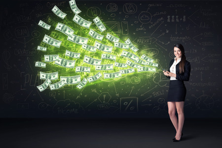 coming out: Businesswoman sitting in chair holding tablet with dollar bills coming out concept on background