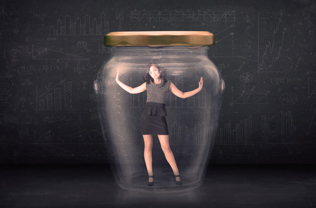 shut: Businesswoman shut inside a glass jar concept concept on background