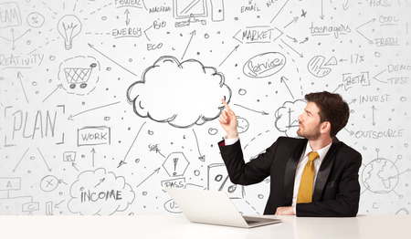 cloud services: Businessman sitting at white table with hand drawn business concept background Stock Photo