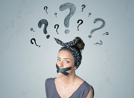 dismay: Young woman with taped mouth and question mark symbols around her head