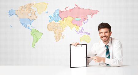 phone professional: Businessman sitting at white table with colorful world map background