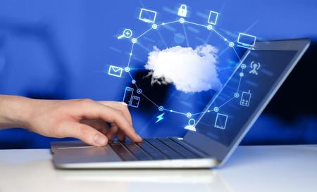 nas: Hand working with a Cloud Computing diagram, new technology concept