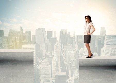 bridging the gaps: Businesswoman standing on the edge of rooftop with city background