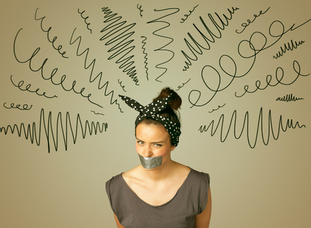 keep an eye on: Young woman with taped mouth and curly lines around her head Stock Photo