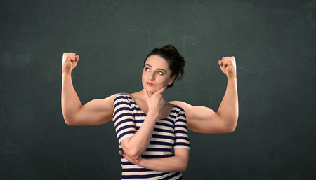 muscled: Pretty young woman with strong and muscled arms concept