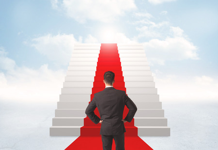 wall clouds: Businessman looking at stairs to heaven