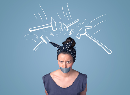 hammer head: Young woman with taped mouth and white drawn beating hammer marks around her head