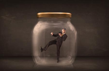 shut: Businessman shut into a glass jar concept on background Stock Photo