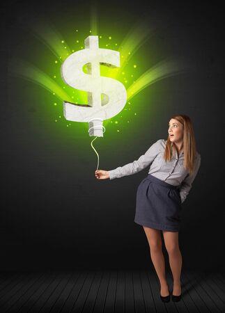 businesswoman skirt: Businesswoman holding a shining, green dollar sign balloon