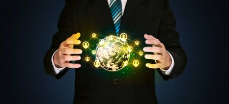 businessman carrying a globe: Businessman holding a shining globe with social media connection Stock Photo