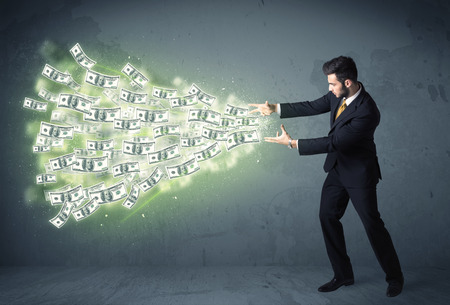 throwing: Business person throwing a lot of dollar bills concept on background