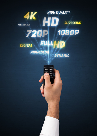 out of control: Hand holding a remote control, multimedia properties coming out of it