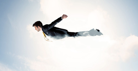 man flying: Business man flying like a superhero in clouds on the sky concept Stock Photo