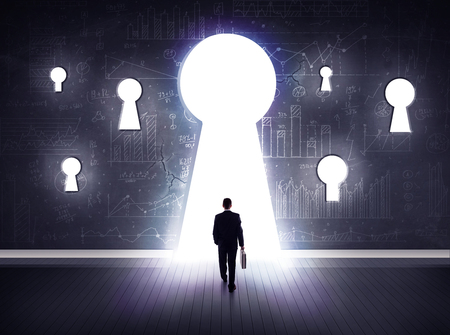 keyhole: Successful businessman looking through keyhole